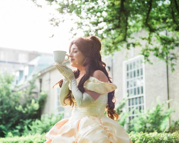 Princess Beauty holding teacup